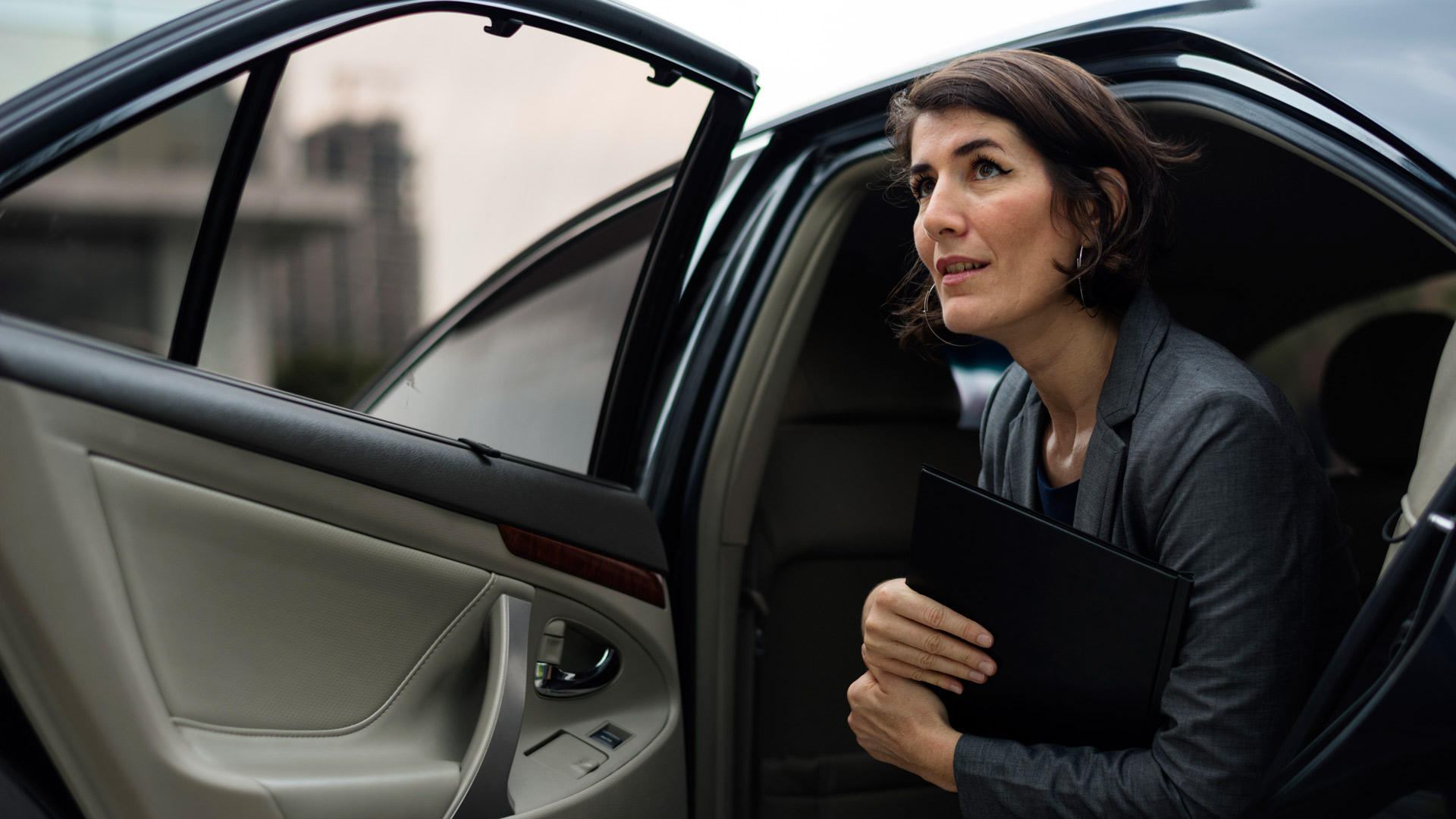 Business woman in corporate transport service